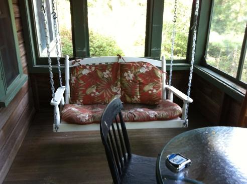 Lake-side porch has a swing.